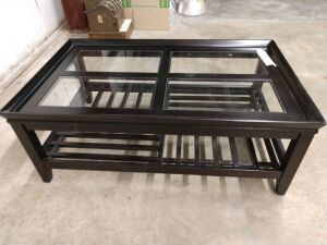 Beautiful 4-ft coffee table, has glass inserts and lowers storage shelf