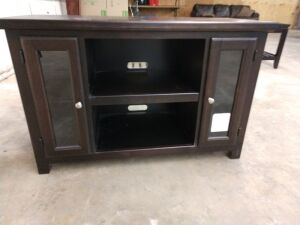 Entertainment center/ cabinet. Does have shelf in center, and storage on either side behind doors