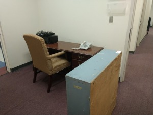R1 LEFT... CONTENT S OF THE OFFICE TO INCLUDE DESK, PHONE, CHAIR, PRINTER, THREE SHELF WOODEN BOOKCASE, FILING CABINET AND GARBAGE CAN