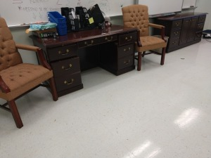 R2 LEFT... LOT INCLUDES DESK, CREDENZA, TOO HIGH BACK TUFTED CHAIRS AND CONTENTS OF DESKTOP, MOSTLY OFFICE SUPPLIES
