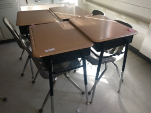R3 LEFT... SET OF FOUR ADJUSTABLE HEIGHT STUDENT DESKS WITH FOUR CHAIRS