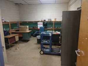 R5 LEFT... LOT INCLUDES CONTENTS OF ROOM TO INCLUDE MISCELLANEOUS NUTS, BOLTS, CLEANERS, DESK, CHAIR, METAL STORAGE CABINET, FILING CABINETS AND MORE, ITEMS NOT ATTACHED TO THE BUILDING