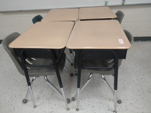 R6 RIGHT... SET OF FOUR ADJUSTABLE HEIGHT STUDENT DESK AND CHAIRS