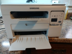 SAMSUNG LASER PRINTER, MODEL 3405W, DOES PRINT AND HAS ALMOST NEW TONER CARTRIDGE