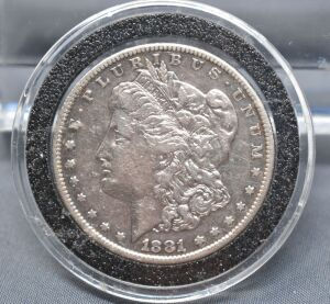 1881 S MORGAN DOLLAR IN CAPSULE
