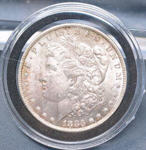1883 O MORGAN DOLLAR IN CAPSULE