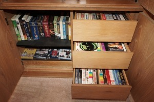 VHS AND DVD MOVIES IN LOW CABINET AREA MARKED 1046 - LR