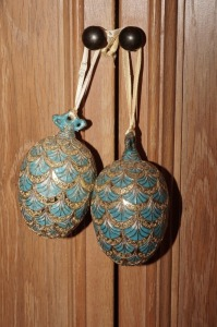 PAIR OF HEAVY DECORATIVE ORIENTAL BALLS WITH SILK STRAPS - LR