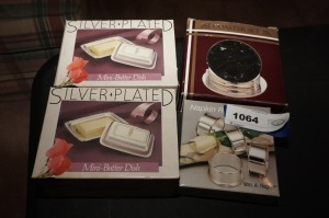 SILVER PLATED PIECES IN ORIGINAL BOXES INCLUDING NAPKIN RINGS, MINI BUTTER DISHES, AND COASTER SET - LR