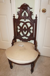 ANTIQUE CHAIR WITH FRONT CASTERS - BR1