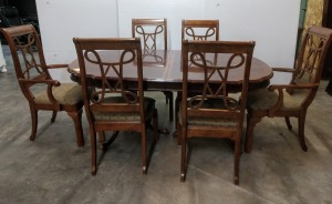 BEAUTIFUL FORMAL DINING SET 70-IN X 44-IN, ALSO INCLUDED IS TWO 15-IN LEAVES, HAS A TOTAL OF EIGHT CHAIRS, TWO OF THEM ARE ARM CHAIRS AND IS SITTING ON TWO VERY NICE THREE-FOOTED PEDESTALS