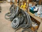 LARGE LOT OF WIREFLEXIBLE RUBBER WIRE SHIELD, ALSO INCLUDES ONE ROLL OF ELECTRIC CABLE,